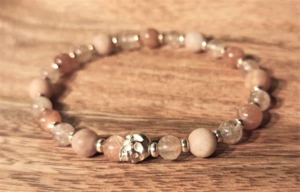 Bracelet pour femme, pierre de soleil et crâne d'argent